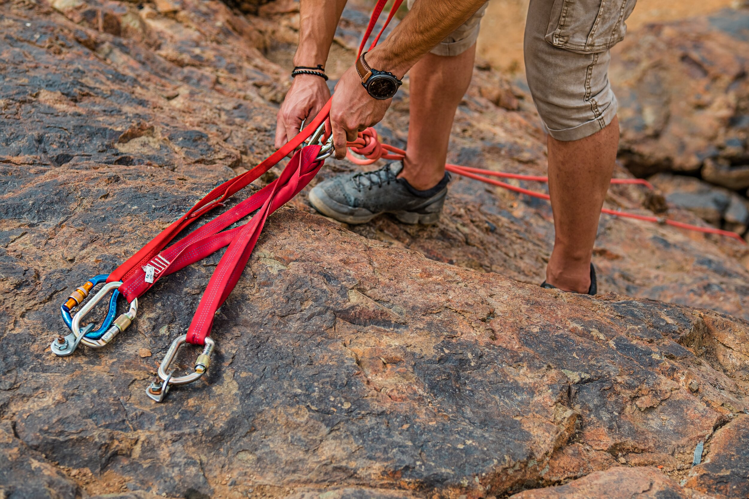person setting up rock climbing gear