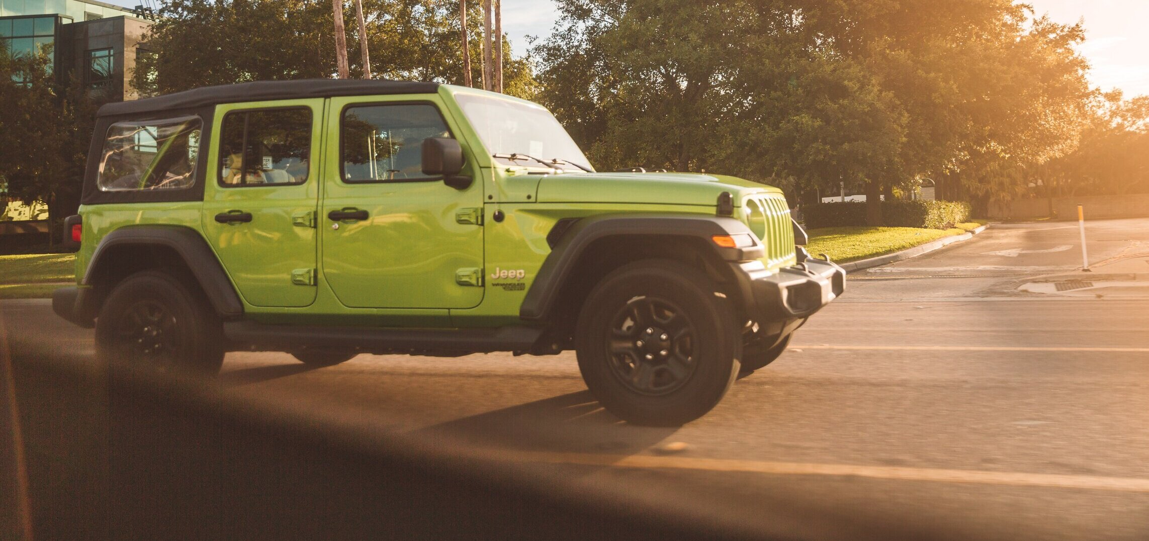 green Jeep in parking lot